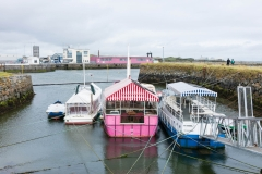 Not sure whether the Owner of the barge painted it this color after seeing the building on the opp side..